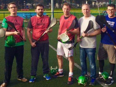 Discover your Inner Warrior Through Hurling! Hats Off, Battle Done! All standing after a hurling game with an American group, Summer 2017.
